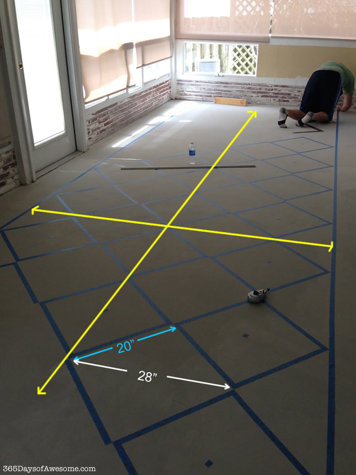How to hand paint checkered floors: Tape the borders, then using the control lines, tape each square.