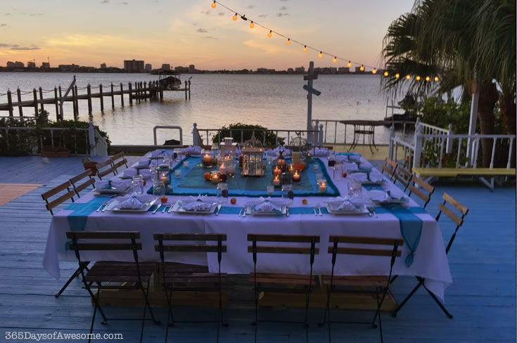 Teal and white linens, candles, string lights and sunset on the water. A perfect outdoor dinner party. Read more about it on my blog.