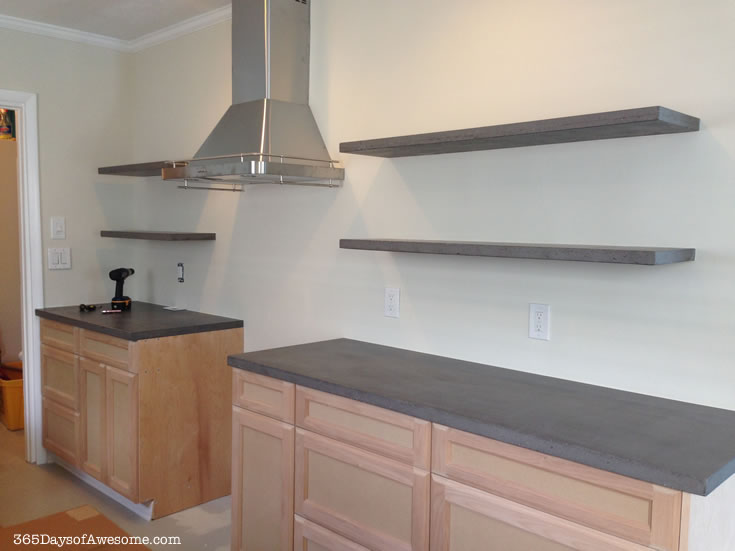 Concrete floating shelves (during kitchen remodel) with no visible brackets.